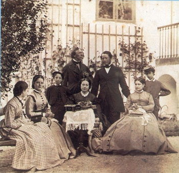 The Melcior family gathered in their garden