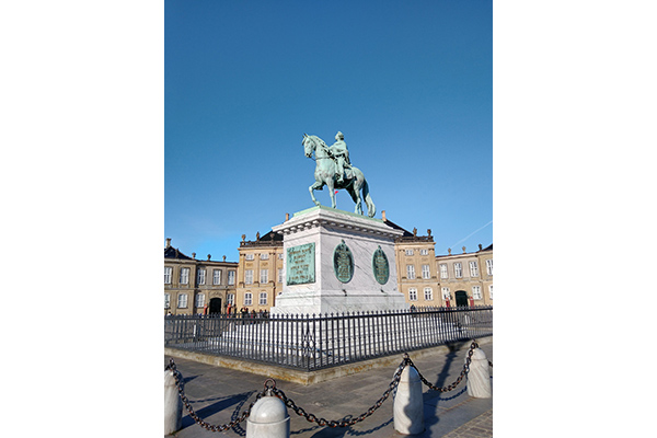 The statue of a man on a horse at Amalienborg castle in Copenhagen
