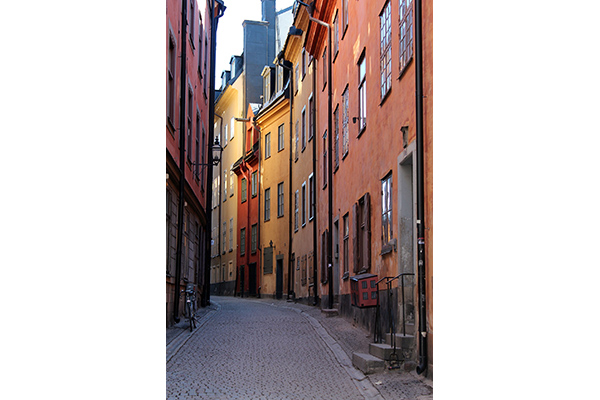 An alley in Gamla stan in Stockholm, with old stone house in different colors